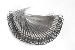 escultura articulada hecha en aluminio, acero y estaño