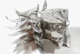 escultura articulada en aluminio de la serie
